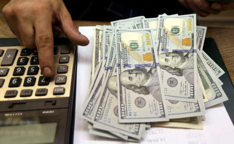 U.S. dollar climbs as new virus outbreaks threaten global outlook 45