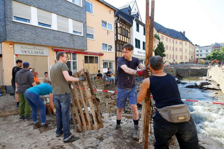 Germany sets out flood relief funding, hopes of finding survivors fade 38
