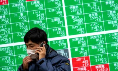 Stocks, markets mixed as Wall Street deciphers diverging signals 47