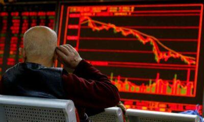 Stocks claw back as markets calm after Evergrande-led slide 64