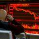 Stocks claw back as markets calm after Evergrande-led slide 65