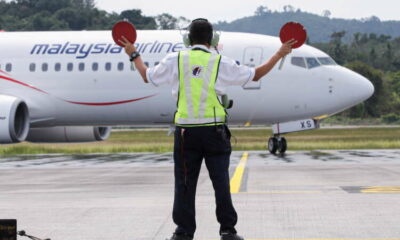 Asia's airlines ramp up flights, offers as tough COVID travel curbs ease 52