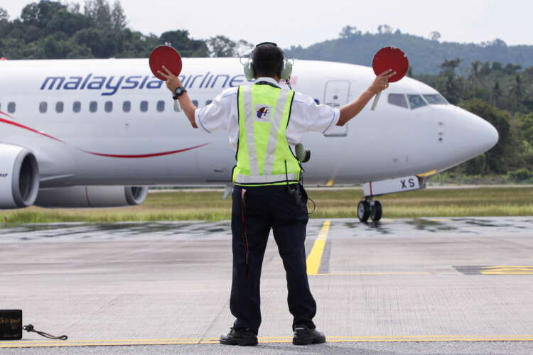 Asia's airlines ramp up flights, offers as tough COVID travel curbs ease 41